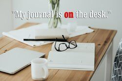 Modern workspace with journal and eyeglasses