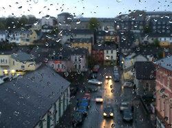 raindrops on window and roofs