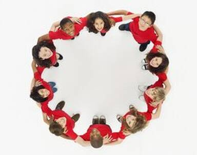 """Smiling children forming an """"O"""" shape"""