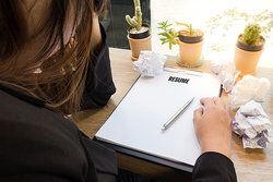woman writing a resume