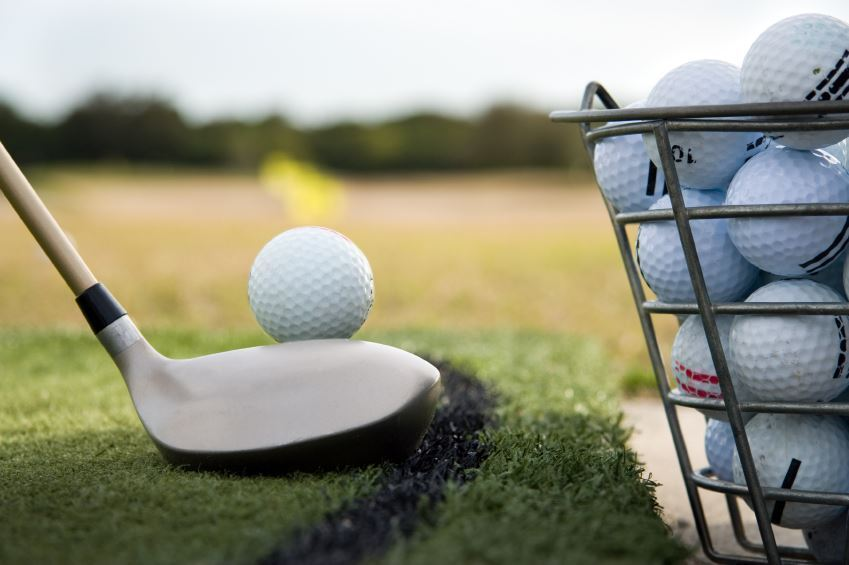 golf ball and club on driving range