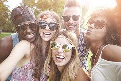 Sociable group of friends taking a selfie