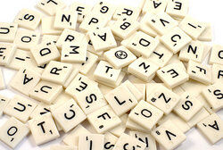 Large pile of Scrabble letter tiles