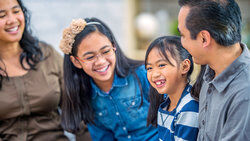 Filipino family laughing together