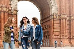 Young women walking and having fun in Barcelona