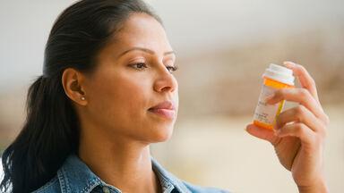 woman reading medication prescription