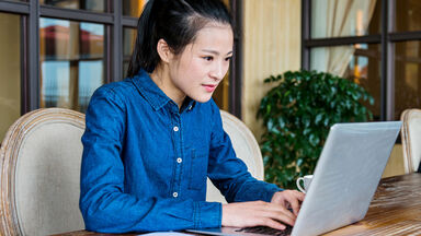 woman doing business and academic writing