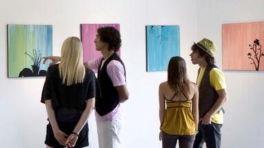 people critiquing art in gallery
