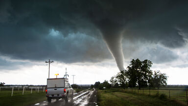 tornado funnel with storm vehicle