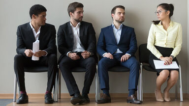 Diverse male applicants with employment sexism prejudice