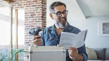 man reading technical user manual
