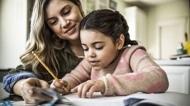 Child and mother working on spelling list