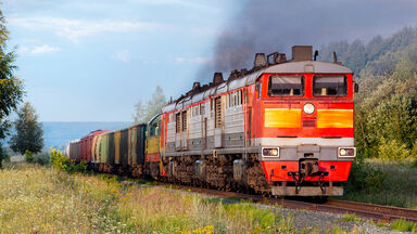 railroad track with locomotive hauling freight