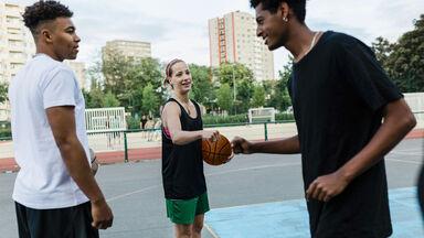 friends playing basketball talking slang