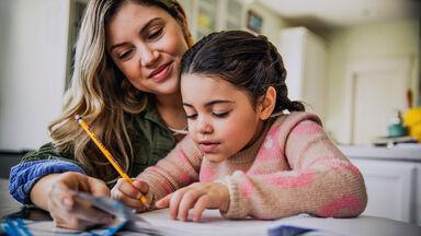parent helping child write