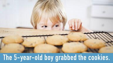5-year-old boy grabbing cookie