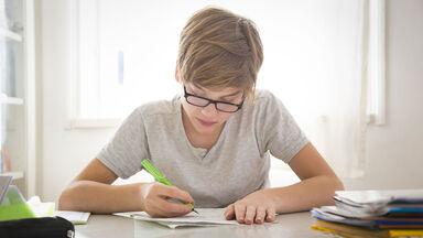 Student doing adjective worksheet for homework