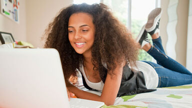 teenage girl writing a personal statement