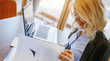 woman writing a case study