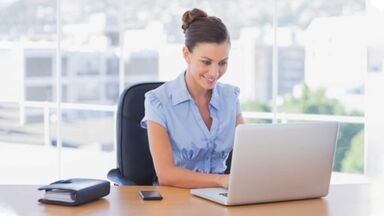 woman writing brief document computer