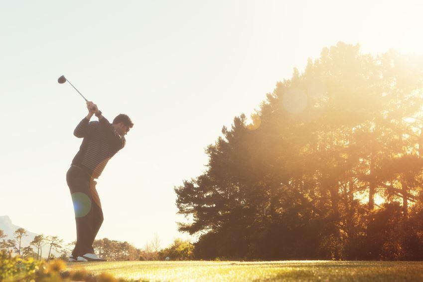 golfer in mid backswing.