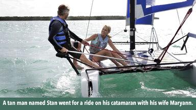 Man on catamaran with his wife Maryann