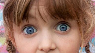 striking astonished eyes on young girl