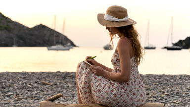 Woman journaling at the beach