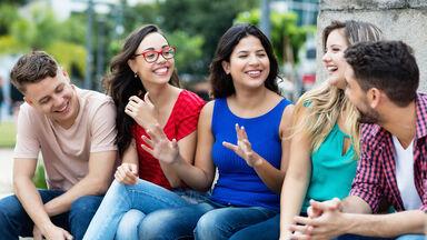 multi-ethnic friends talking