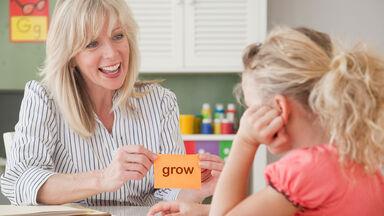 Teacher holding up grow flash card