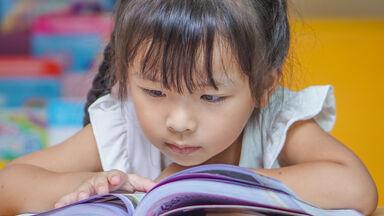 Kindergartener reading book