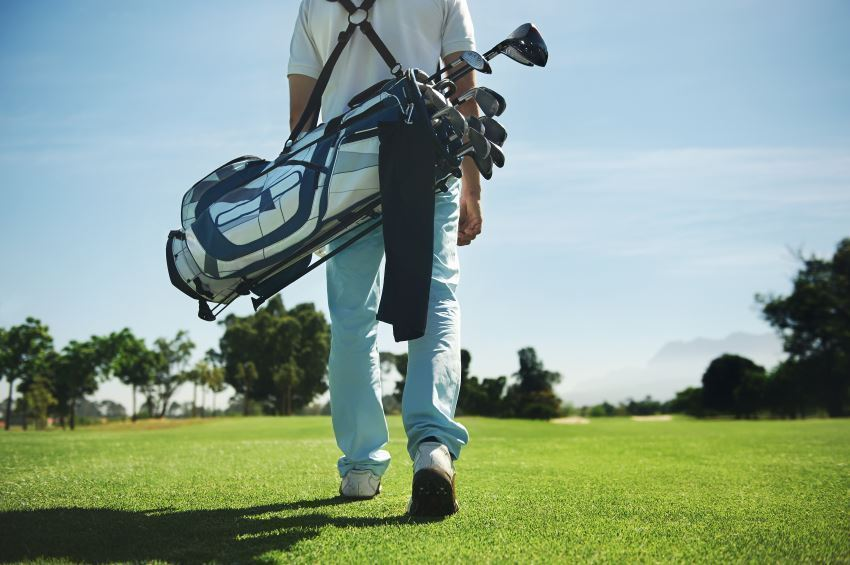 golfer with bag on his back