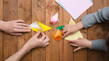 folding origami animals with paper sheets