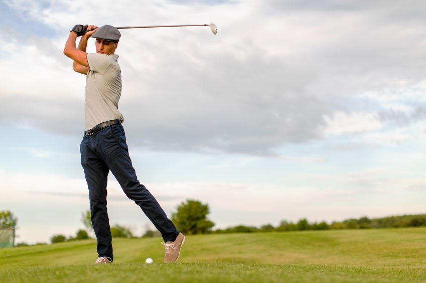 golfer at the top of his backswing