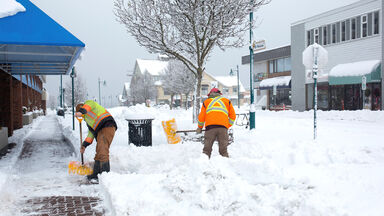 workers shoveling snow from winter storm