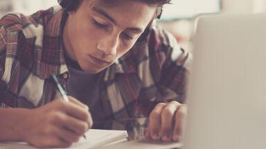 Student Writing Critical Analysis Essay
