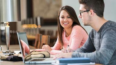 Students writing Evaluation Essay Using Effective Reasoning