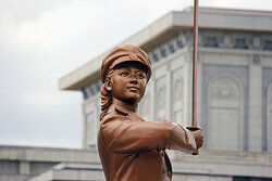 Statue of a woman as examples of communism