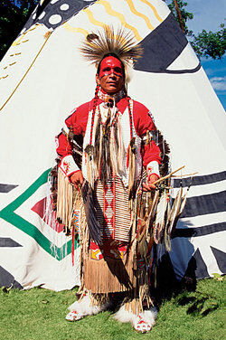 Native American in front of teepee as examples of genocide