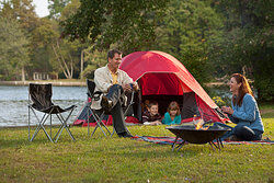 Family camping with a tent as examples of hindsight bias