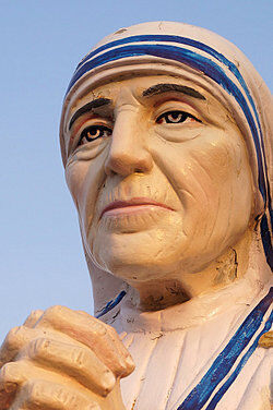 Statue of a person praying as examples of humility