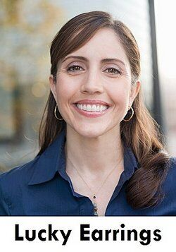 Smiling woman wearing hoop earrings as examples of illusory correlation