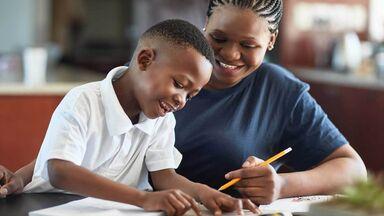 woman teaching 1st grade grammar to student