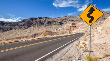 iconicity example winding road sign