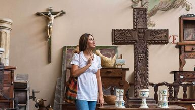 woman shops for crosses iconography example
