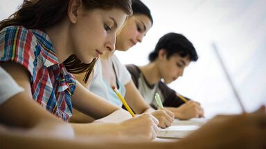 high school students writing verb tense