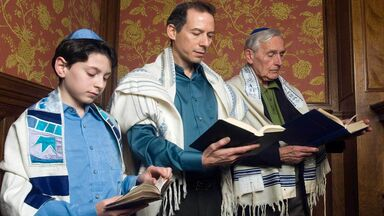 religious social institutions with three generations reading Torah