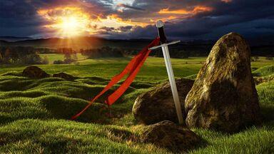 sword in stone medieval landscape
