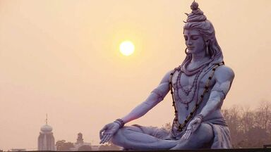 hindu god shiva statue at sunrise