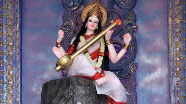 hindu goddess Saraswati playing musical instrument